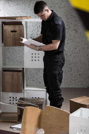 work area: Image of policeman during investigation at home