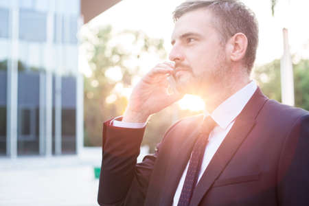 corporate building: Portrait of professional manager during work standing outside corporate building Stock Photo