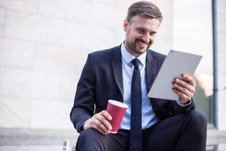 smiling businessman: Picture of content smiling businessman after successful deal Stock Photo