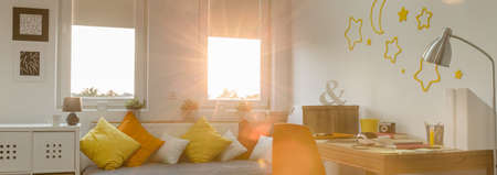 white window: Panorama of light and warm teenager room interior