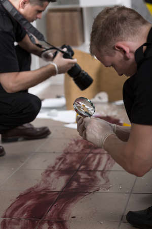 murder scene: Police officers working at the murder scene