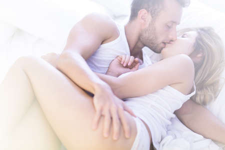 sex tenderness: Picture of attractive man and woman kissing with passion Stock Photo