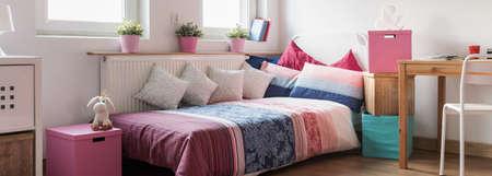 girlish: Panorama of girlish sleeping area with colorful comfortable bed Stock Photo