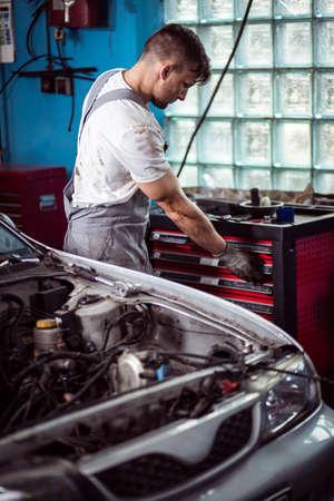 automobile repair shop: Image of automobile repair shop worker during labor