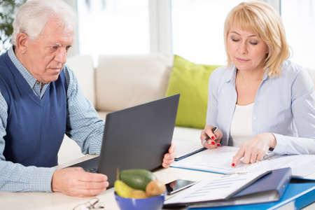 senior men: Two senior busy people checking the business plan