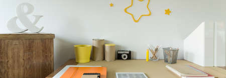 contemporary: Close up of wooden functional study table for child Stock Photo