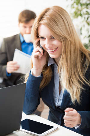 woman business suit: Women working in corporation talking on the phone