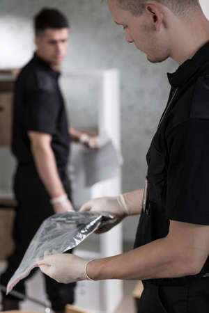 criminal investigation: Forensic scientist preventing gun at the crime scene