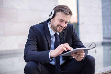music listening: Image of office worker listening music during break