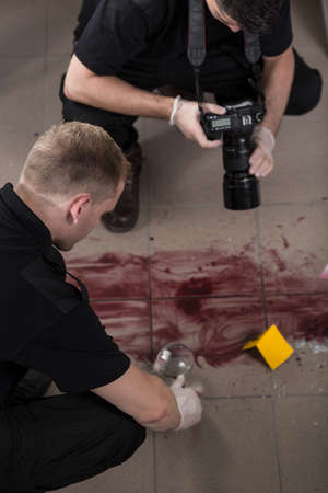 forensic: Close-up of forensic technicians taking evidences of crime Stock Photo