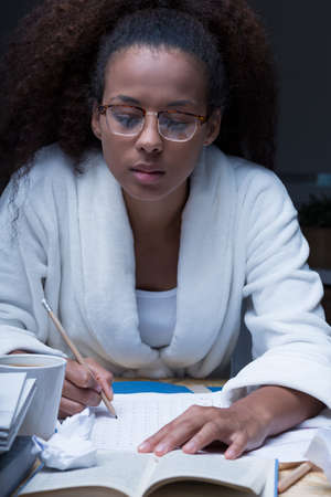 forgetful: Forgetful female student doing homework at night