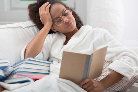 african student: Female African American student studying before exam Stock Photo