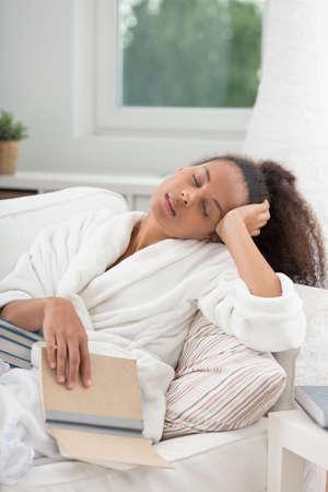 asleep: African American woman falling asleep while reading