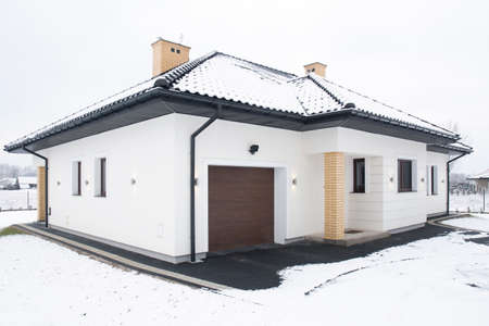 cottage house: External view of single-family home at winter