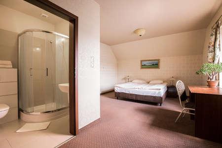 hotel room door: Roomy bedroom and bathroom in the hotel