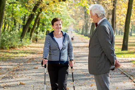senior woman: Active senior woman nordic walking in park