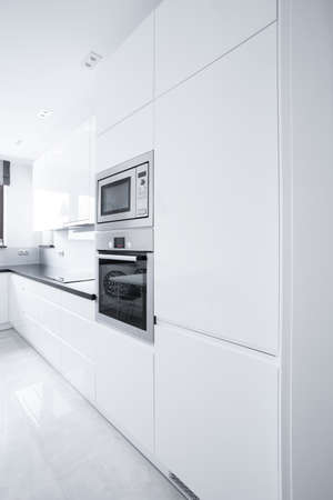 Close-up of white kitchen unit in modern house