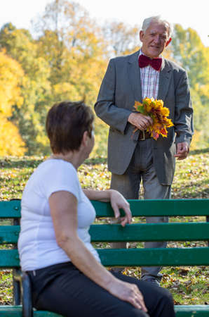 lovers park: Romantic elderly man holding bouquet of color leaves Stock Photo
