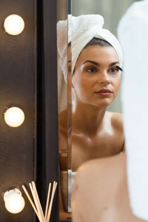 prepare: Beauty woman doing make up in the bathroom Stock Photo