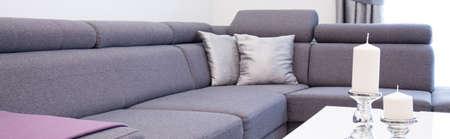 violet residential: Close-up of angular sofa in elegant interior Stock Photo