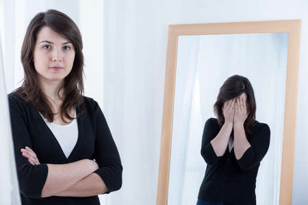 mood: Portrait of desperate woman hiding her bad mood Stock Photo
