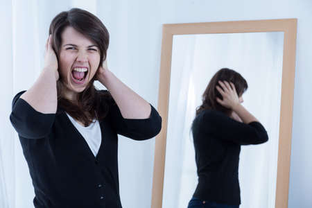 irate: Photo of young irate screaming woman