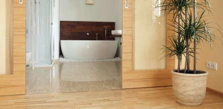 merbau: View of a modern en suite bathroom from a bedroom.