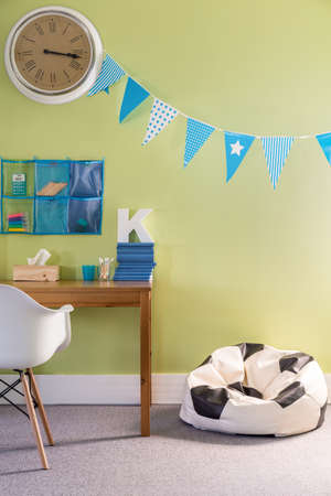 stylish boy: Picture of boy room with comfortable football sack chair