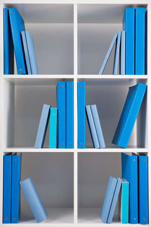 organized unit: Close up of simple style white bookcase for study room Stock Photo