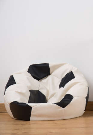 comfortable chair: Close up of comfortable trendy soccer ball bean bag chair Stock Photo