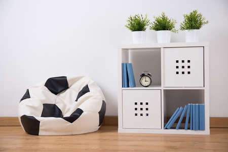 organized unit: Picture of shelving unit and new sit in teenager room Stock Photo