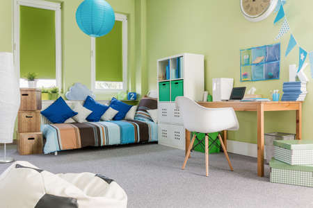 bed room: Photo of spacious modern design green boy room Stock Photo