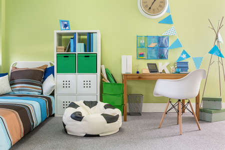 stylish boy: Picture of functional stylish furniture in new child room Stock Photo