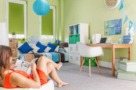 cosy: Image of teenager relaxing in cosy colorful interior