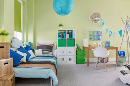 decor: Picture of spacious kid room with sleeping and study area Stock Photo