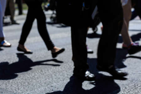 street people: Close up of pedestrian crossing and people walking in hurry