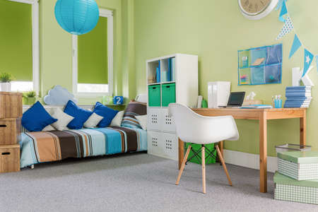 cosy: Image of green cosy furnished functional room for child