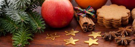 christmas decor: Christmas decoration, fruits and sweets on wood