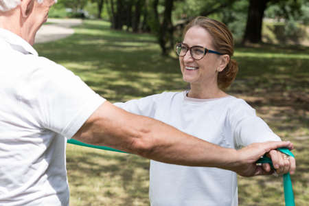 elastic band: Picture of elderly pair workout with fitness elastic band Stock Photo