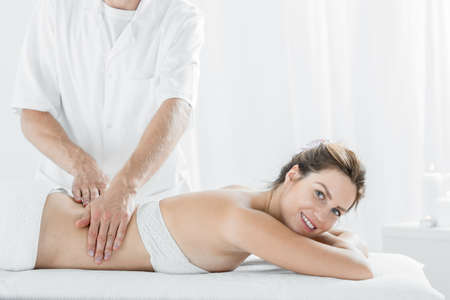 Picture of beautiful young woman during relaxing massage