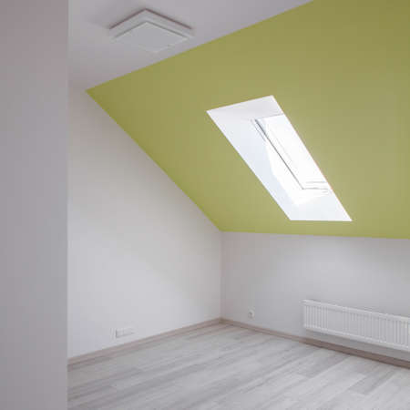 inclined: Empty white room with yellow inclined wall