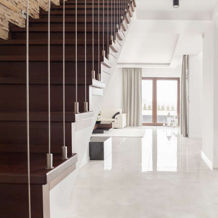 wooden stairs: Photo of bright spacious interior with wooden stairs Stock Photo