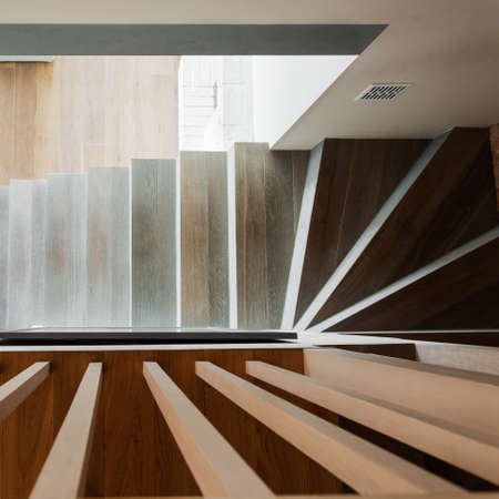 Close-up of spiral wooden stairs in modern residence