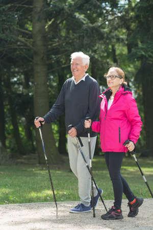 strolling: Picture of elder pair strolling with trekking sticks