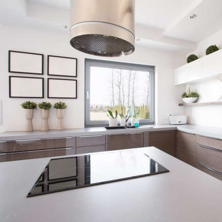 kitchen island: Up-to-date decor of kitchen with hob on island