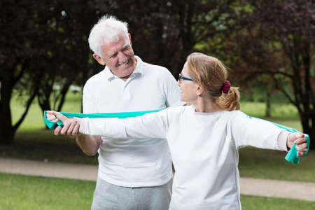 senior woman exercising: Photo of fit elderly male and female during outdoor physical activity