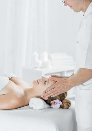 Picture of happy woman having professional scalp massage