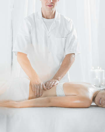 Picture of male masseur doing professional therapeutic massage Stock Photo
