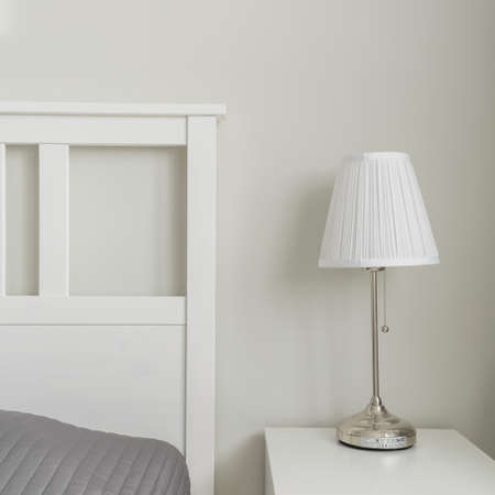 designed: Close-up of space near bed designed in simple way