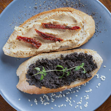 Healthy tasty sandwiches with hummus and tapenade Stock Photo